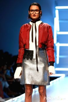 a-model-walks-the-ramp-displaying-an-outfit-by-397550