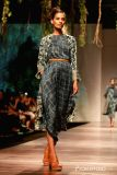 a-model-walks-the-ramp-displaying-an-outfit-by-397705